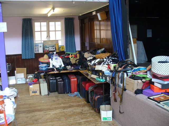A corner of the Jumble Sale devoted to every sort of bag from purses to suitcases